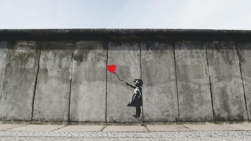 girl playing heart balloon wall artwork