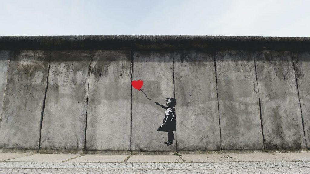 banksy girl playing heart balloon wall artwork